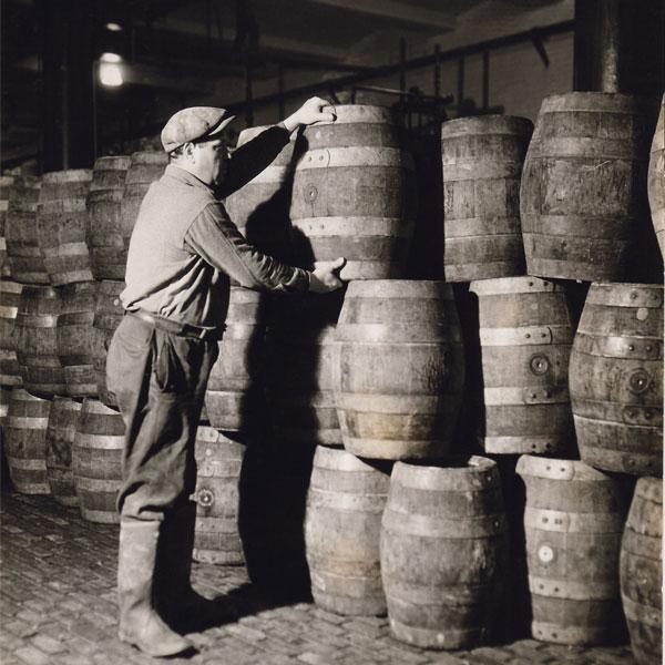 Man-stacking-barrels_square